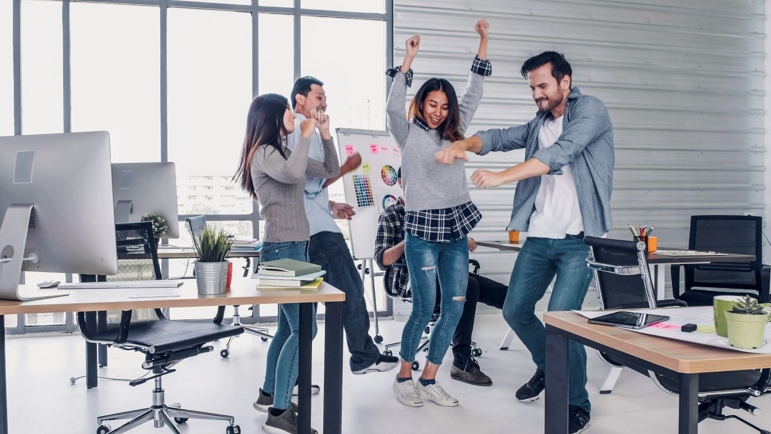 employees dancing in the office