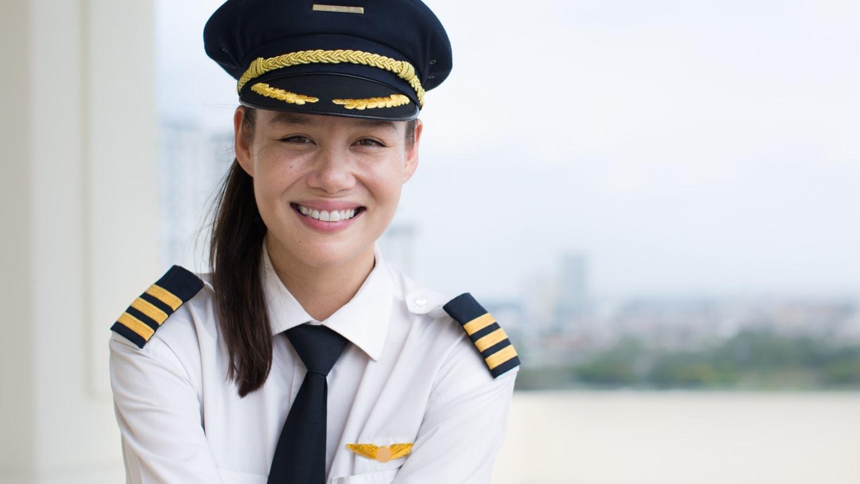 woman pilot smiling at the camera