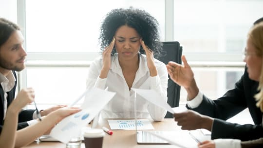 woman overwhelmed in a meeting