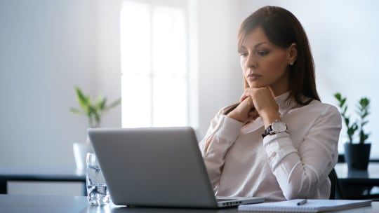 Woman thinking about how to intervene in a conflict