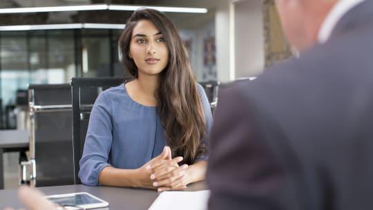 Woman watching someone speak