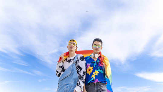 gay couple with pride flag