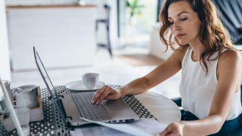 Woman looking at resume